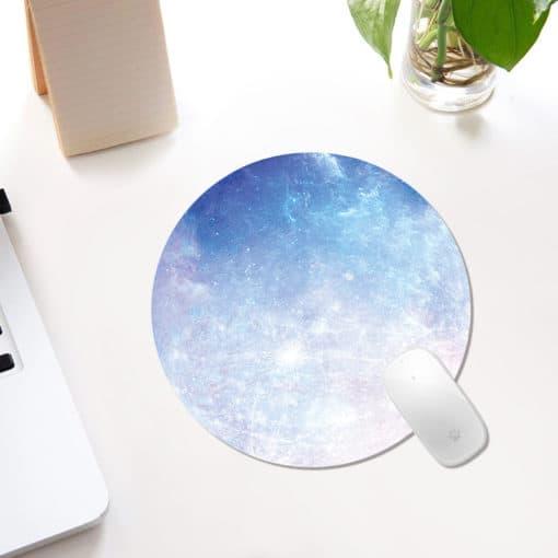 tapis de souris rond qui représente une planète